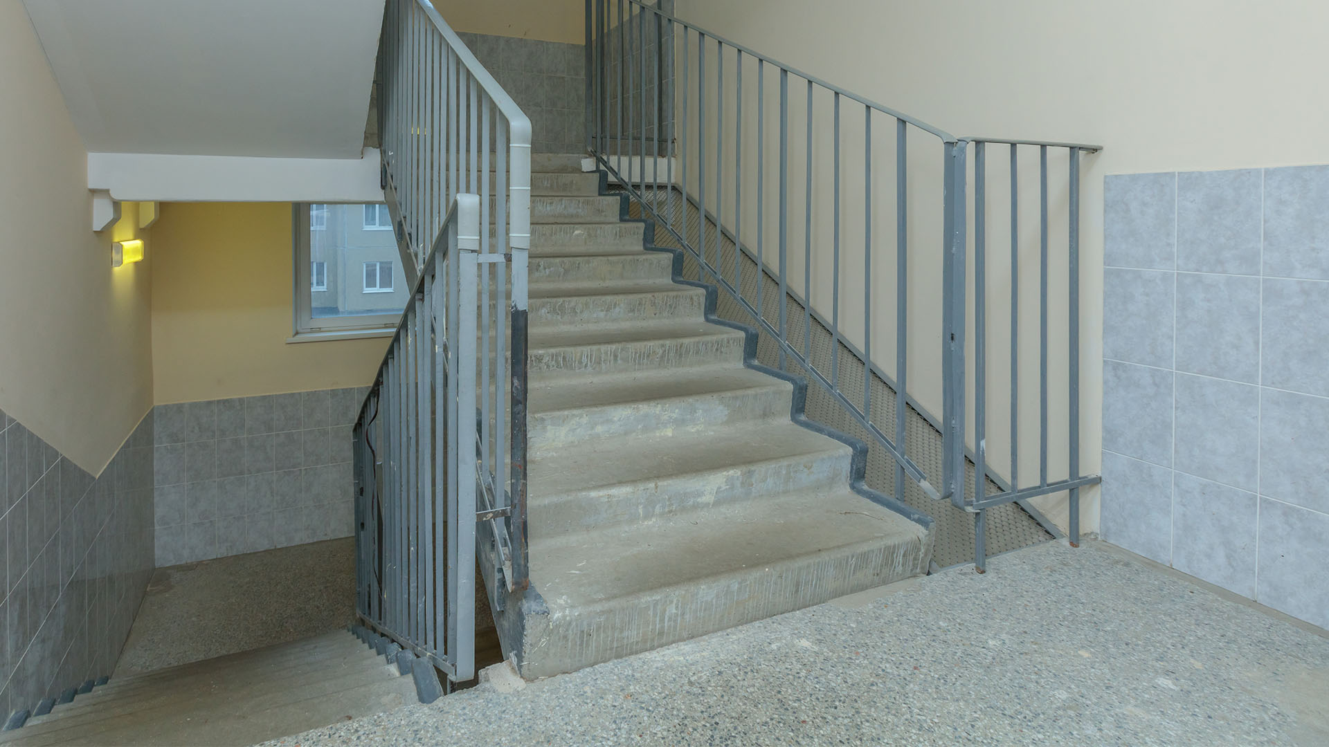 apartment building stairwell with metal handrail