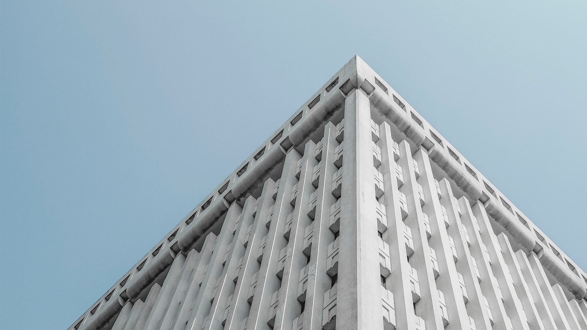 view of white office building from ground