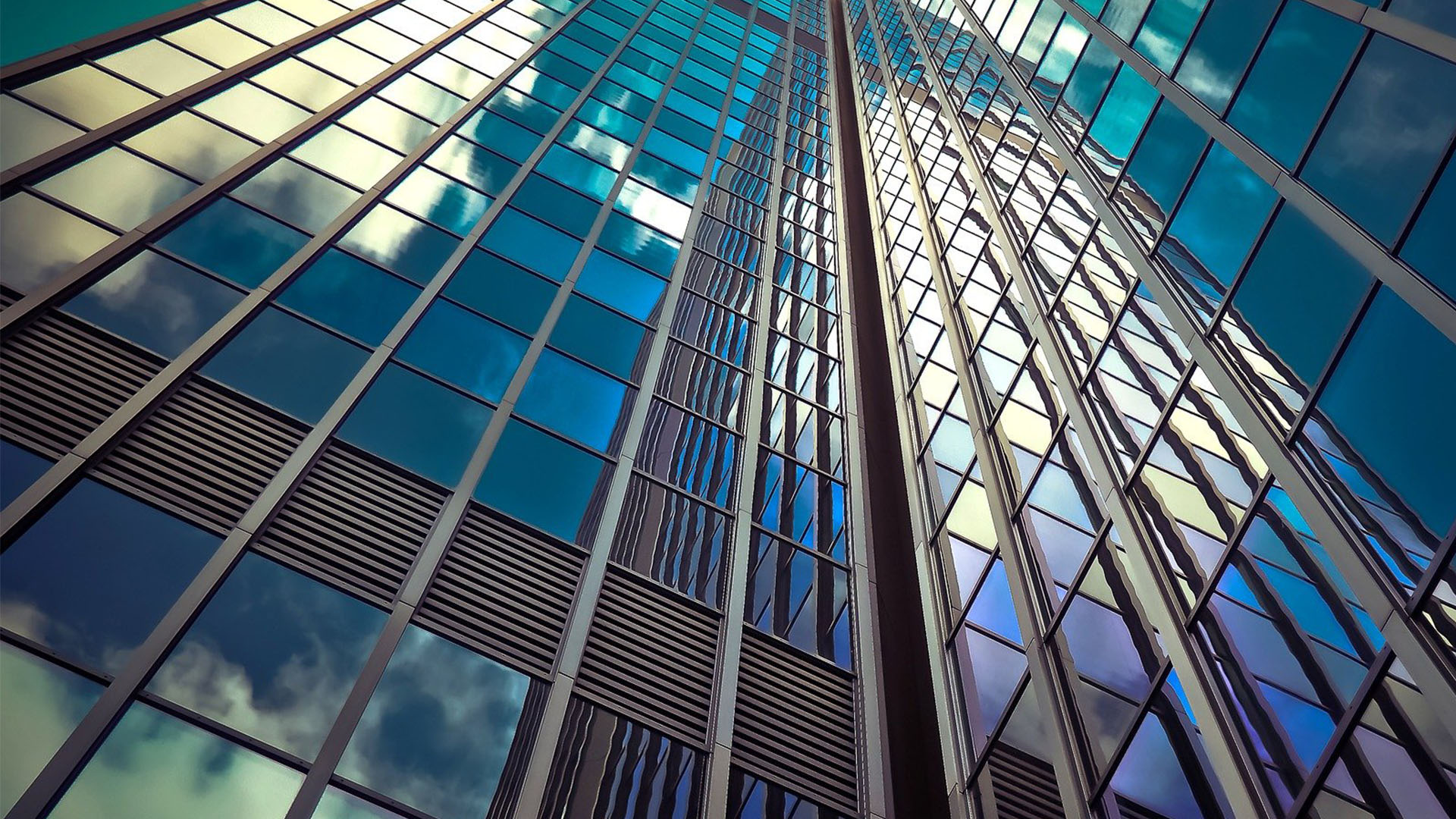 view of tall office building from the ground