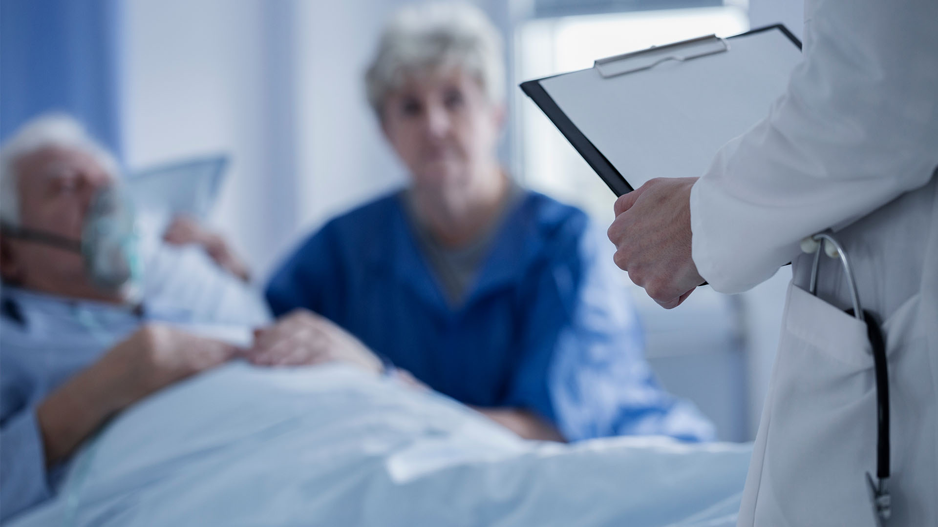 loved one talks with doctor about patient in hospital