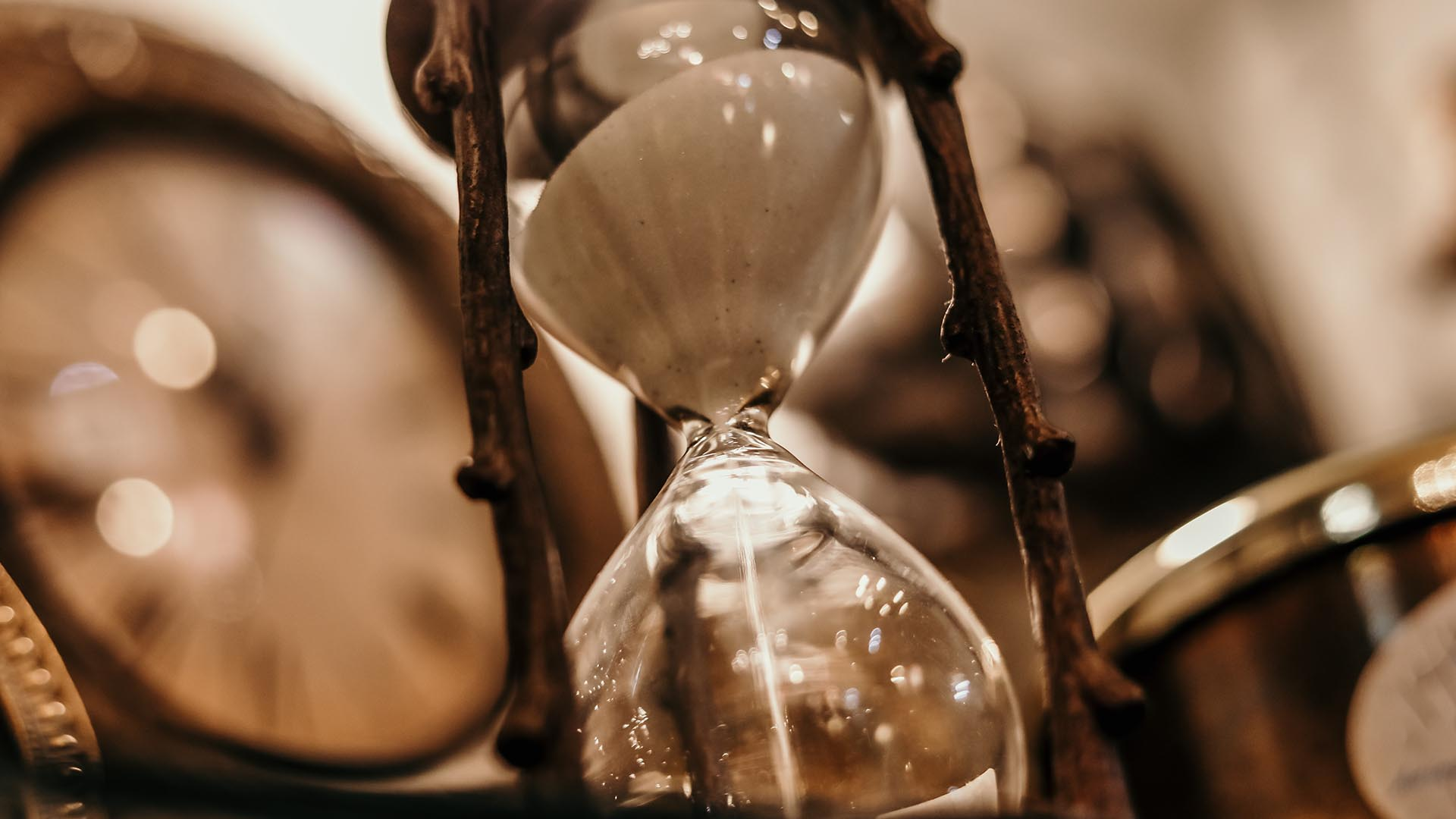 close up of an hourglass with sand falling