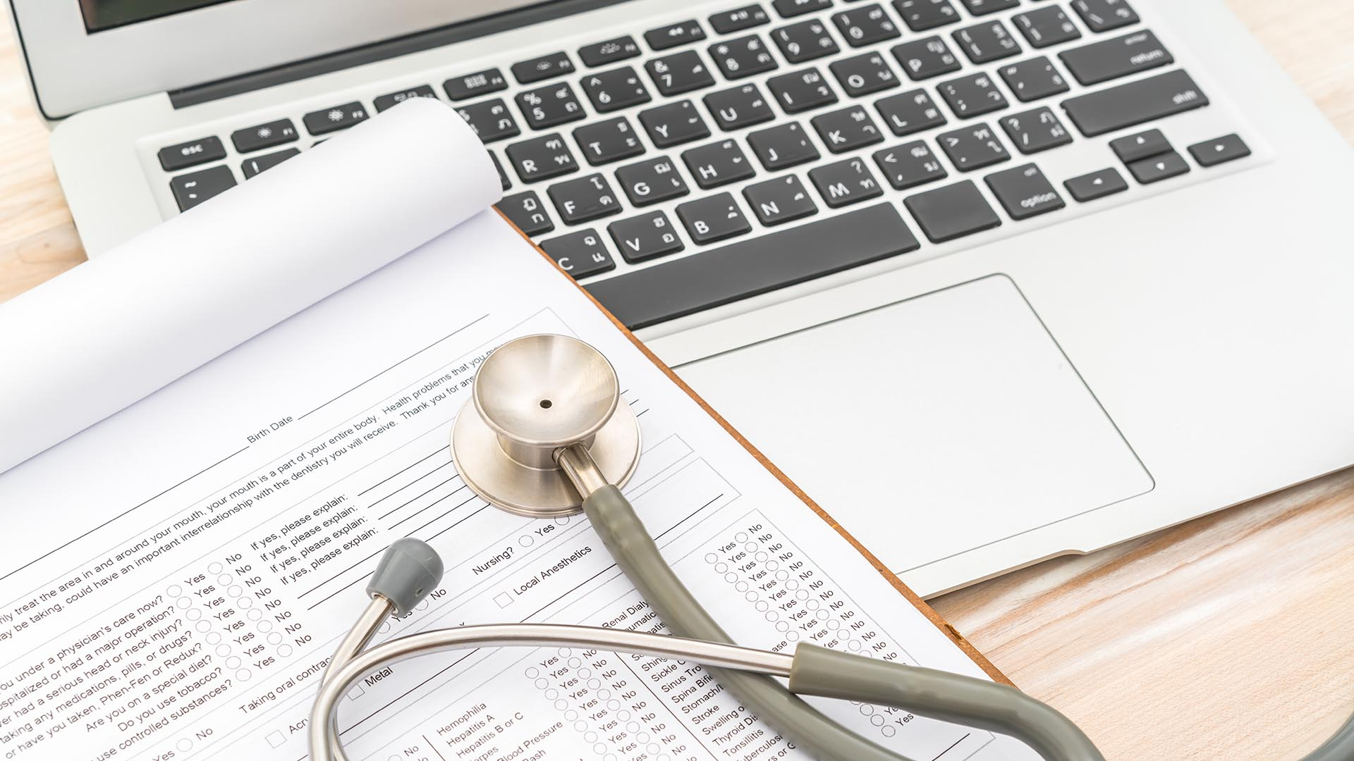 stethoscope, paperwork, and laptop